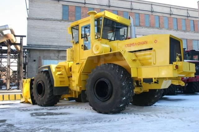 Кировец К-702МБА-01-БКУ. Бульдозер колесный , 14 860куб. см., 20 800кг.