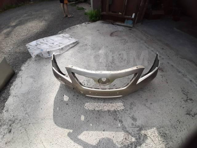 Передний оригинальный бампер на Toyota Camry 40 дорестайл 52119-33942