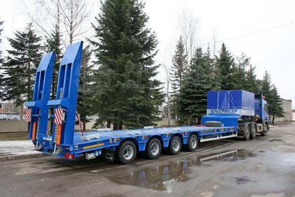 Спецприцеп. Низкорамный 4-х осный трал СпецПрицеп 9942L4, мехтрапы 13 гр, 52 тонны, 52 000кг.