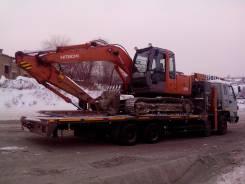 Услуги эвакуатора спецтехники грузовиков