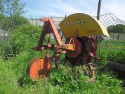 Картофелекопатель тракторный навесной