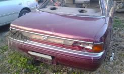 Mazda Persona, 1990