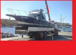 Спуск катера на воду, перевозка катера, эвакуатор.