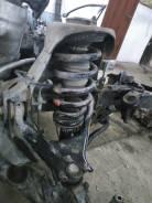 Стойка амортизатора передняя Mitsubishi L200
