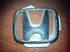 Эмблема с решетки радиатора