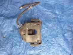 Суппорт тормозной передний левый Mazda Demio DY3W DY5W Verisa DC5W