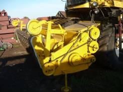 Подборщик для зерноуборочного комбайна ньюхоланд.