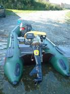 Лодка с мотором и прицепом