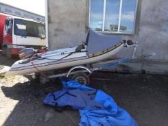Лодку моторную надувную ПВХ с навесным двигателем и заводской телегой.