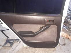 Обшивка двери Toyota Camry, левая задняя