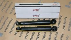 Амортизатор задний LYNX Nissan Rnessa 4WD