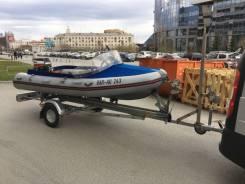 Лодка с мотором и прицеп