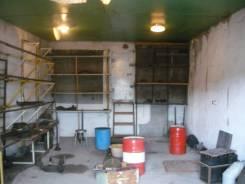 Кооперативный каменный гараж с жилой комнатой.