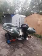 Лодка RIB с мотором и прицепом.
