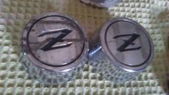 Продам заглушку-эмблему колесного диска Nissan Fairledy-Z280
