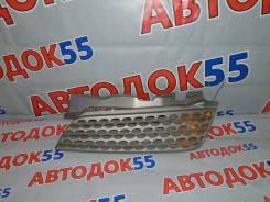 Решетка радиатора Nissan March, левая AK12