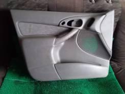 Обшивка двери Ford Focus1
