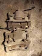 Суппорт тормозной Nissan Sunny FB15 QG15