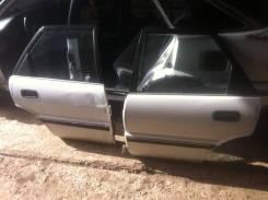 Стекло двери заднее левое Toyota Sprinter Cielo AE91