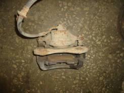 Суппорт тормозной передний левый [581802SA70] для Hyundai ix35, Kia Sportage III