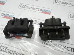 Суппорт тормозной передний левый KIA Sorento XM