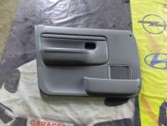 Обшивка передней левой двери Mazda Demio DW3W, B3ME