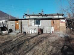 Продам два гаража кап. и хозяйственные постройки на земельном участке