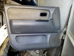 Обшивка двери передняя левая MMC Chariot 91-97гг