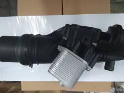 Корпус масляного фильтра с радиатором 06D117021CFTE VAG 2.0L BWA, AXX, BPY, BPY, BYK, BYD, BWE c 2002 г.