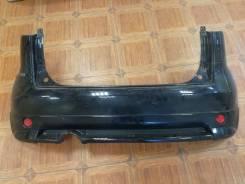 Бампер задний Nissan Note(E11) 05-12 год с губой черный Rider 006568