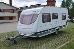 Chateau. Дом на колесах Calista 450, с большой каркасной палаткой.
