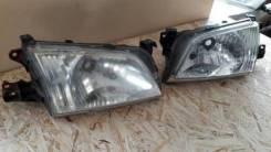Фара левая Mazda Demio 1996-2002