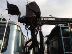 Гидроманипулятор HIAB 060 с грейферным захватом.