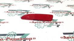 Отражатель в задний бампер Mazda2 03-06