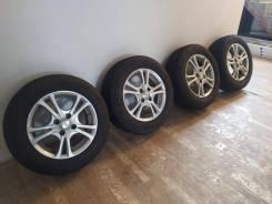 "Литье + Bridgestone Revo GZ 185.65.14. 14.0x14"" 4x100.00 ET35 ЦО 54,1мм."