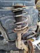 Стойка амортизатора Toyota Camry V40