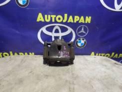 Суппорт передний левый Toyota Ractis SCP100 б/у 47750-52211