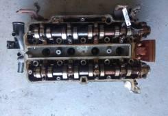 Головка блока цилиндров двигателя (ГБЦ) б/у для Opel Corsa D