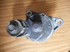 Натяжитель приводного ремня Ford Focus 1