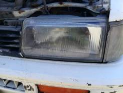Продам левую фару на Toyota Corolla CE80