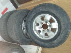 Комплект колёс вместе с литьем Nissan Terrano. Bridgstone 265.70.15
