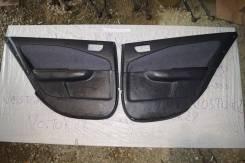 Обшивка двери Toyota Carina 211