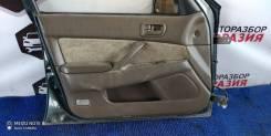 Обшивка двери передняя левая Toyota Camry CV40