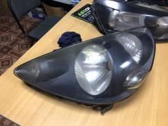 Фара P1680 черная Honda Fit 33151SAA003
