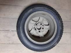 Автомобильную шину на диске
