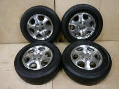 Колеса 205/70-15 на литых дисках Subaru