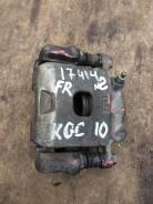 Суппорт передний правый Toyota Passo KGC10