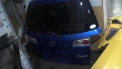 Стекло заднее Mazda Demio