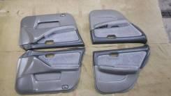 Обшивка дверей Nissan Laurel комплект 4шт