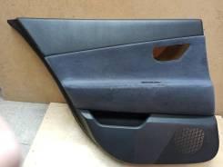Обшивка двери задняя левая Nissan Primera 05-08 (левыйруль)